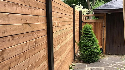 Horizontal privacy Wood fence with Dark Brown vinyl posts