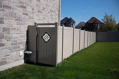 Tan, privacy Gate with metal insert
