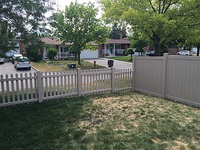 Tan Cape Cod Picket fence