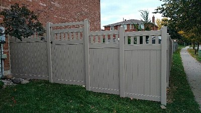 Tan, privacy fence with Vinyl picket top