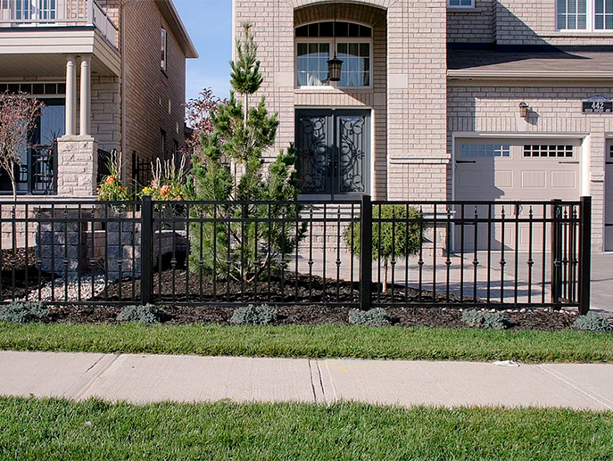 Vinyl fence installed around front yard garden of Toronto home